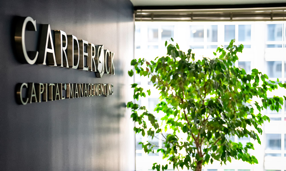 Carderock Capital Logo in office lobby wall with window view